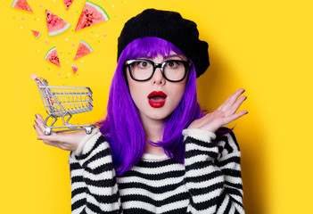 woman with purple hair and shopping cart