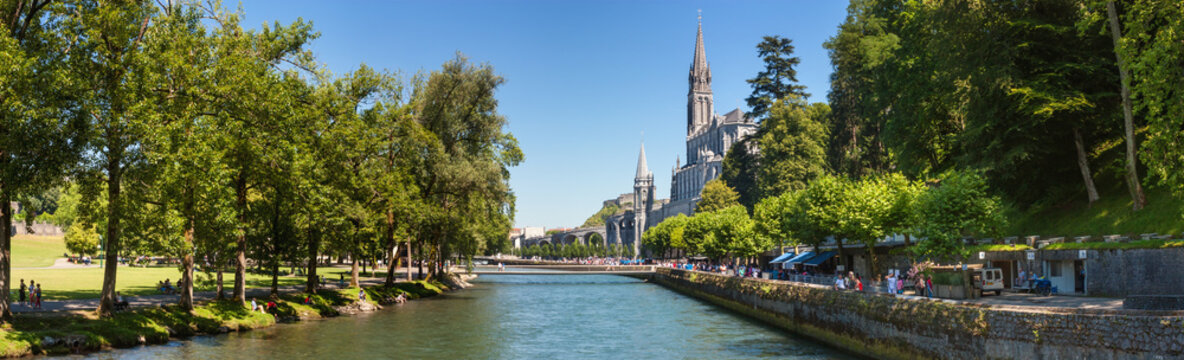 Panoramic view of the city Lourdes - the Sanctuary of Our Lady of Lourdes, the Hautes-Pyrenees department in the Occitanie region in south-western France.