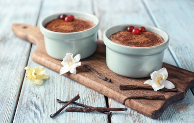 Composition with tasty vanilla pudding on wooden background