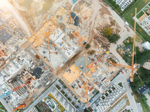 Aerial view of construction site with crane and building. Top view of big development construction and architecture.