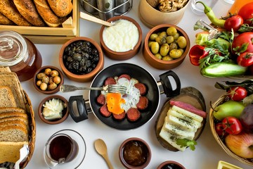 Traditional rural Turkish breakfast in ceramic pots.Close up taken,isolated.