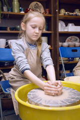 girl in a pottery workshop