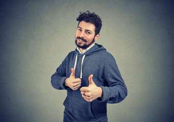 cheerful man excited with win showing thumbs up