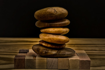 A stack of flat rocks on a black background