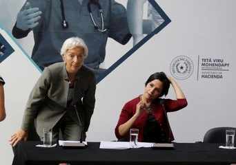 Christine Lagarde and Lea Gimenez arrive for a news conference in Asuncion