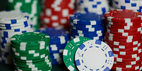 stacks of poker chips on a poker table in a casino representing a win after gambling.