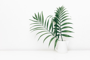 Minimal empty space, stylish hipster background with green tropical leaves in jar Wall mural