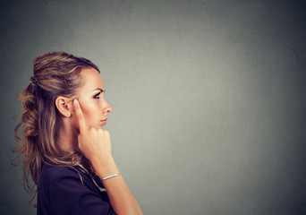 Pensive woman looking for solution
