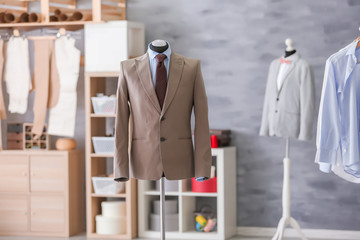 Mannequin with elegant suit in tailor's workshop