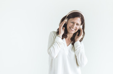Woman enjoying the music isolated