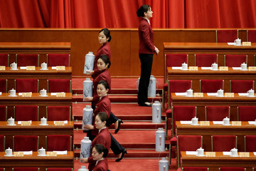 Attendants are seen before the closing session of the Chinese People's Political Consultative Conference (CPPCC)