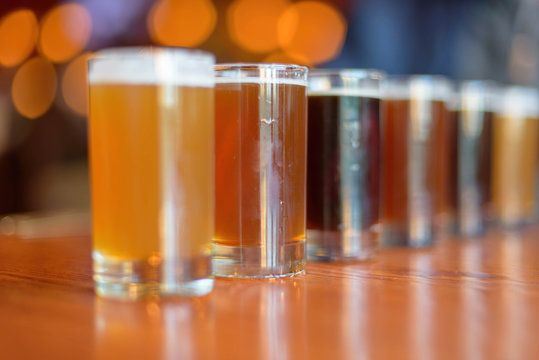 Low angle close up of beer flight lined up on the table