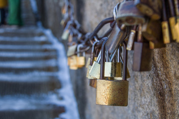 Group of locked love padlocks on rusty railing on the mountains with togetherness and love faithfulness concept.with copy space