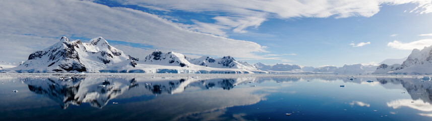 Iceberg reflections on calm water in the Paradise Bay of Antarctica.
