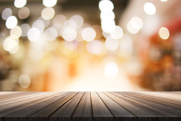 wood table top with blur bokeh background backsrop for product present