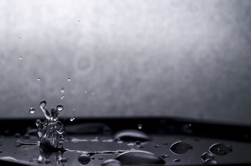 A black and white photograph of a drop falling.