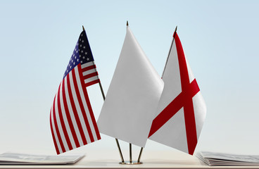 Flags of USA and Alabama with a white flag in the middle