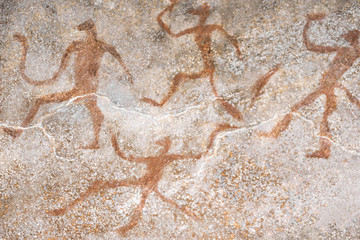 image of ancient people on the wall of the cave ocher. history. archeology.