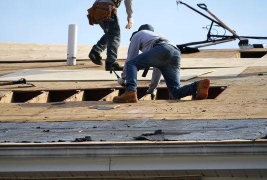 Handyman working on repairing the roof