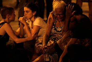 Women react next to the crime scene where Rio de Janeiro city councilor Marielle Franco was shot dead in Rio de Janeiro, Brazil
