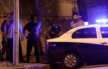 A police investigator inspects the body of Rio de Janeiro city councilor Marielle Franco after she was shot dead in Rio de Janeiro