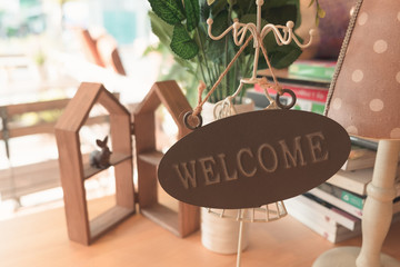 Wooden welcome sign for decorating in the shop