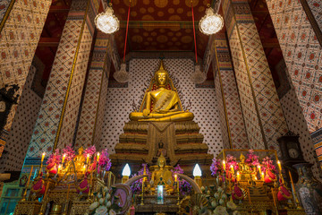 Inside the temple of Wat Arun Ratchawararam showing the image of golden Buddha