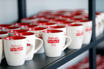 Bahrain FinTech Bay logo is seen on coffee mugs at its office in Bahrain Bay, Manama