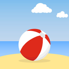 Beach ball lying in the sand. Beach ball against the blue sky.