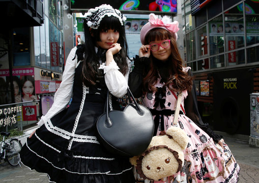 """Ai and Hamuka dressed in """"Lolita fashion"""", influenced by Victorian style, pose for photographs at  Harajuku shopping district in Tokyo"""