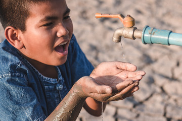 Children are glad to have water to drink in the water shortage of water.