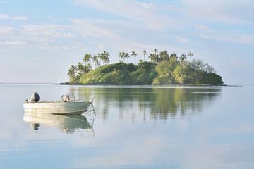 Fishing boat mooring over calm waters at Muri Lagoon Rarotonga Cook Islands