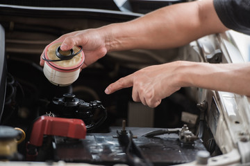 Close up of hand holding fuel filer, It is essential to clean or change or replace truck's diesel fuel filter after a certain period, car maintenance service concept.