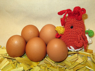 Easter decoration. Knitted hen and fresh eggs on burlap