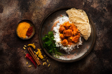 Chicken tikka masala spicy. Indian meat dish in metal plate, rice and naan bread