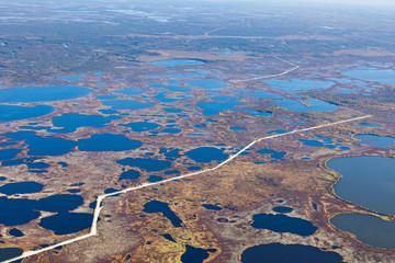 Top view of gas pipeline in endless swamps in tundra