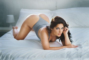 sexy glamour model posing on bed