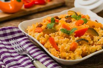 Millet with vegetables and raisins.