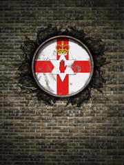 Old Northern Ireland flag in brick wall