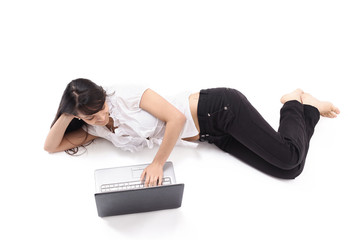 young woman with laptop lying on the floor .isolated on white