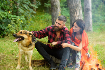 Dog training concept. Woman and man on vacation,