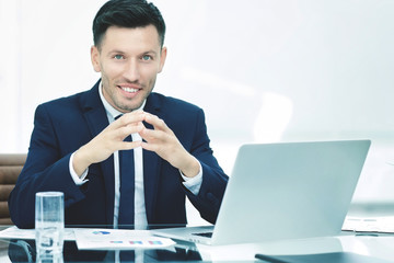 successful businessman at the workplace working with financial d