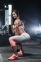 strong sexy athletic young girl working out in gym
