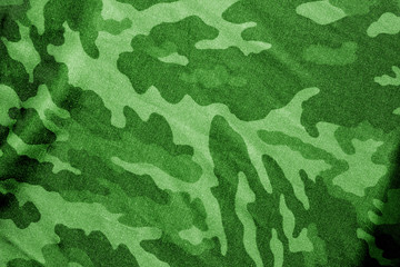 Military uniform pattern in green tone.