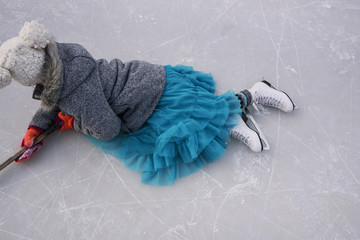 High angle view of a girl practicing ice hockey