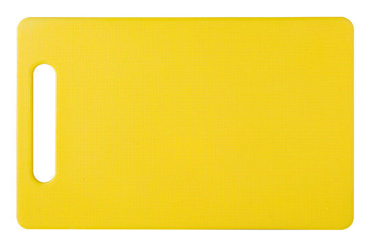 yellow plastic cutting board, new board, top view, white background
