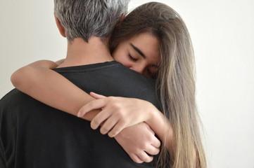 Teenage girl hugging her father