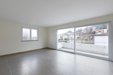Empty room with large window on the balcony, empty space