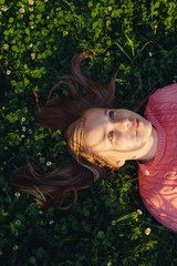 Smiling girl lying in a meadow