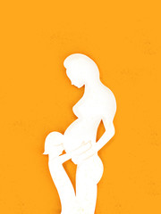 Silhouette of a pregnant mother with a toddler hugging her bump